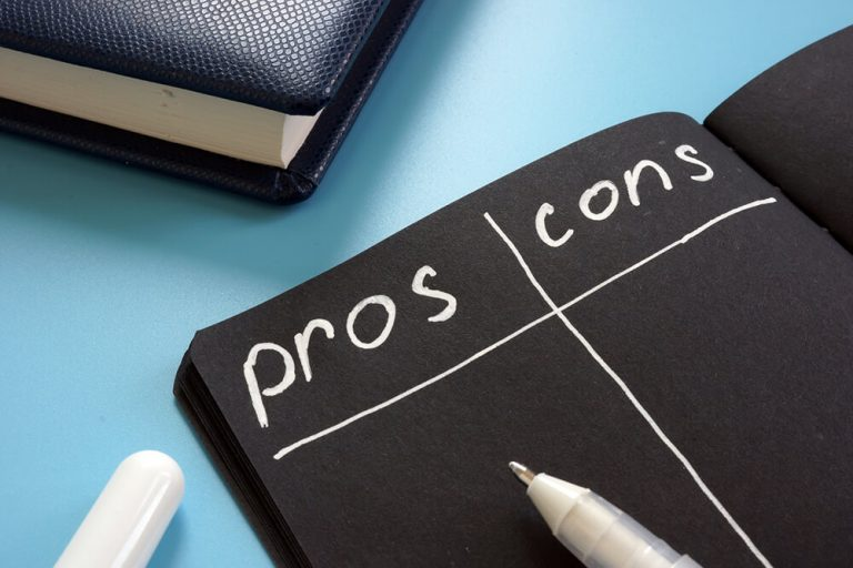 illustration of a pros and cons list on black paper