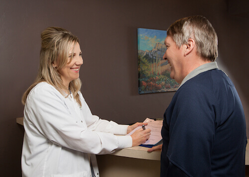 Dr. Jacqueline Bennett consults with a dental patient